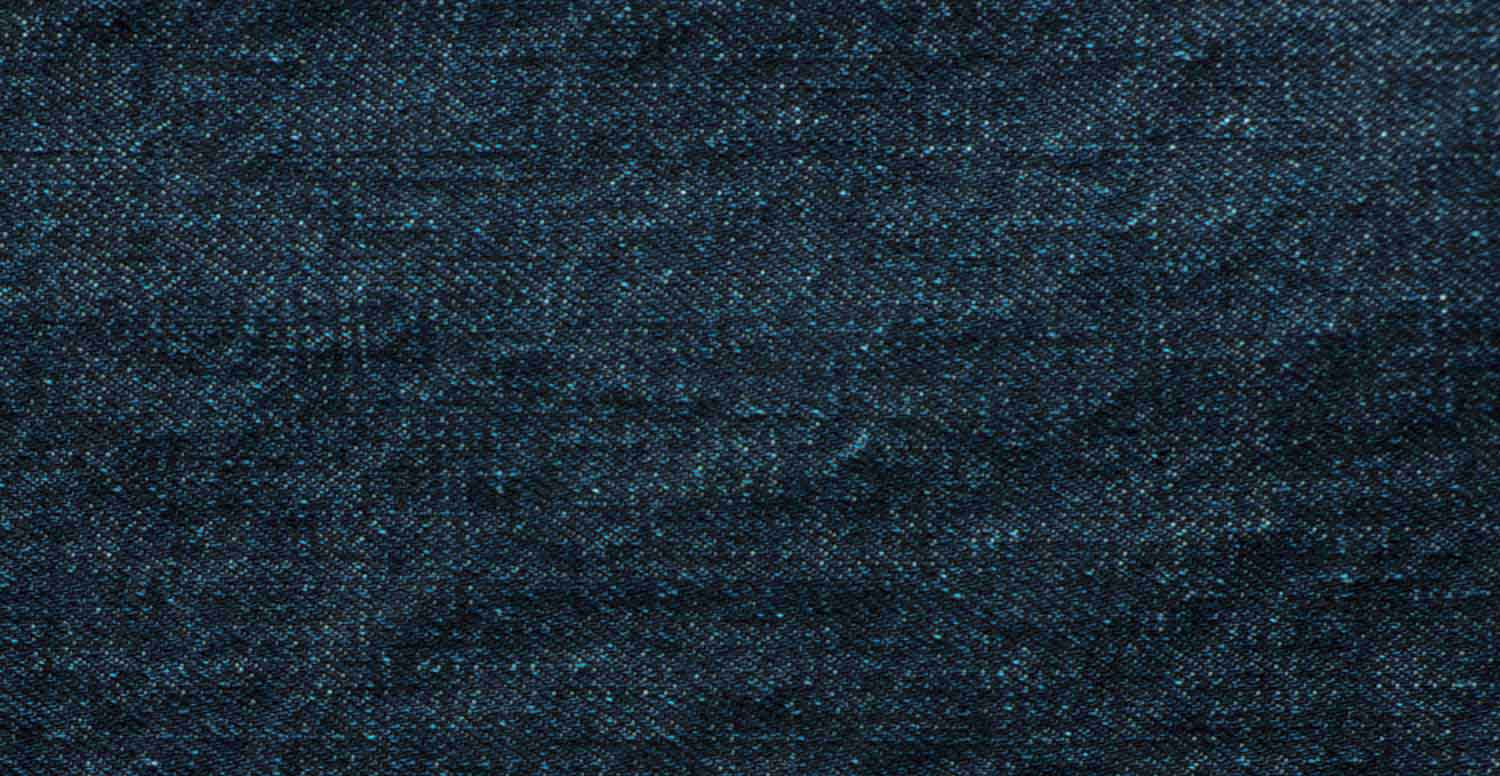 Comparison between a raw denim fabric before and after treatment with Garmon's denim fixing  products