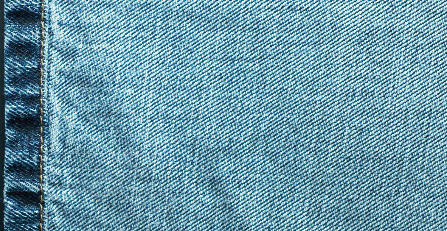 Comparison between a raw denim fabric before and after treatment with Garmon's desizing products