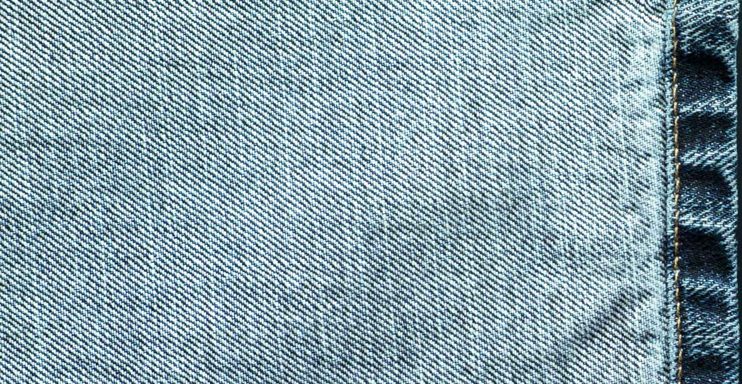 Comparison between a raw denim fabric before and after treatment with Garmon's dispersing products