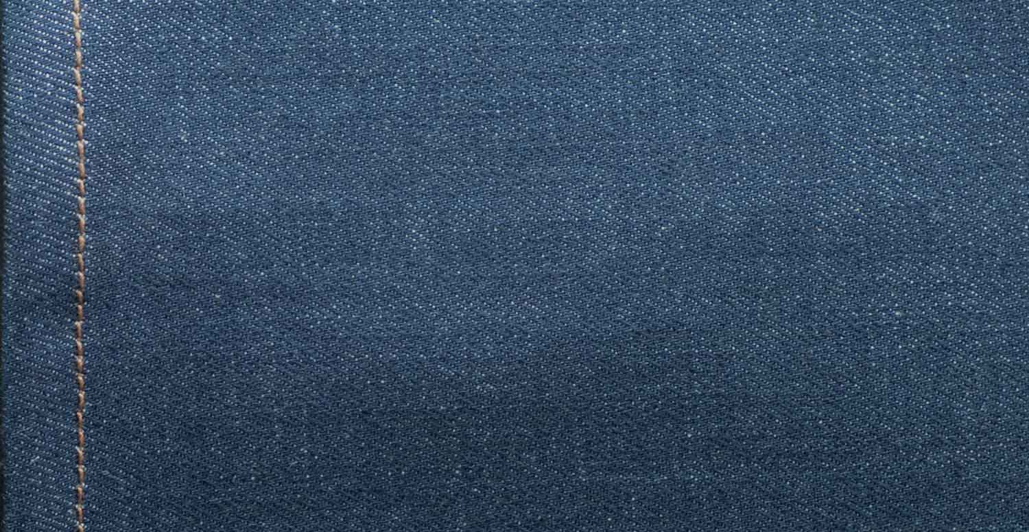 Comparison between a raw denim fabric before and after stone washing with Garmon's Geopower Nps